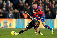 3rd November 2019; Selhurst Park, London, England; English Premier League Football, Crystal Palace versus Leicester City; James McCarthy of Crystal Palace fouls Ricardo Pereira of Leicester City  - Strictly Editorial Use Only. No use with unauthorized audio, video, data, fixture lists, club/league logos or 'live' services. Online in-match use limited to 120 images, no video emulation. No use in betting, games or single club/league/player publications