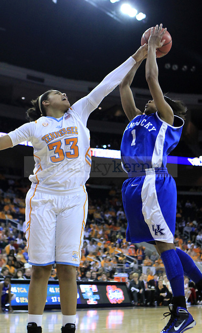 Tennessee's Alyssia Brewer steals the ball from freshman guard A'dia Mathies during the second half of the UK women's basketball game against Tennessee for the SEC tournament at the Gwinnett Center on Sunday, March 7, 2010. UK lost to Tennessee  70-62. Photo by Adam Wolffbrandt | Staff
