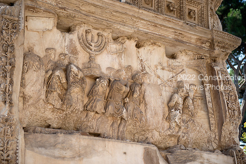 Detail of the Golden Menorah in the Arch of Titus, located on the Via Sacra, just to the south-east of the Roman Forum in Rome, Italy, which was built to commemorate Titus's victory in Judea, depicts a Roman victory procession with soldiers carrying spoils from the Temple, including the Menorah, which were used to fund the construction of the Colosseum, on Wednesday, October 23, 2013.  It was constructed c. 82 AD by the Roman Emperor Domitian shortly after the death of his older brother Titus to commemorate Titus' victories, including the Siege of Jerusalem in 70 AD. The Arch is said to have provided the general model for many of the triumphal arches erected since the 16th century&mdash;perhaps most famously it is the inspiration for the 1806 Arc de Triomphe in Paris, France, completed in 1836.  This, the south panel, depicts the spoils of war looted from the Temple in Jerusalem after its destruction by the Romans. The Golden Menorah is the main focus and is carved in deep relief. Other sacred objects being carried in the triumphal procession are the Gold Trumpets and the Table of Shew bread. These spoils were likely originally colored gold, with the background in blue. In 2012 the Arch of Titus Digital Restoration Project discovered remains of yellow ochre paint on the menorah relief.  <br /> Credit: Ron Sachs / CNP
