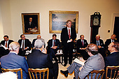 United States President Bill Clinton consults with the bipartisan Congressional leadership on the situation in Somalia in the Roosevelt Room of the White House in Washington, DC on October 7, 1993.  From left to right: US Senate Minority Leader Bob Dole (Republican of Kansas), US Senate Majority Leader George Mitchell (Democrat of Maine), US Secretary of Defense Les Aspin (partially obscured), US Vice President Al Gore, President Clinton, US Secretary of State Warren Christopher, Speaker of the US House Tom Foley (Democrat of Washington), US House Majority Leader Dick Gephardt (Democrat of Missouri).  Also visible at lower right are US Senator Sam Nunn (Democrat of Georgia) and US Senator J. Strom Thurmond (Republican of South Carolina).<br /> Credit:  White House via CNP