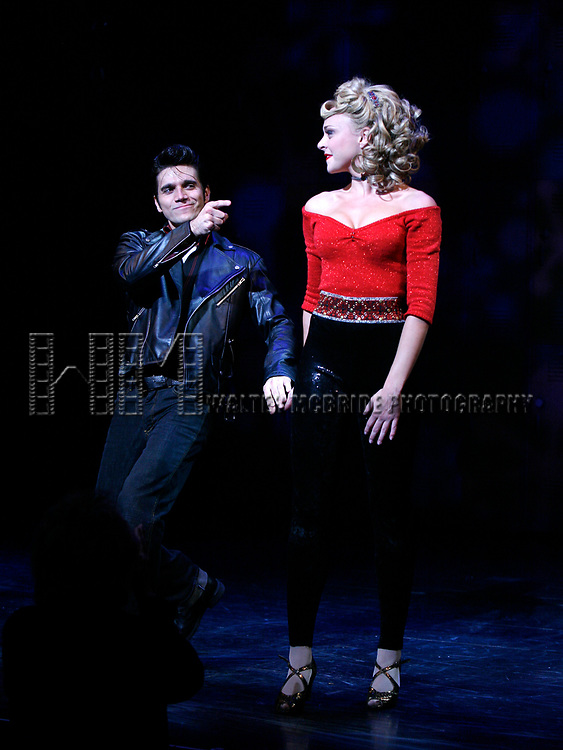 Derek Keeling & Ashley Spencer take a bow during Olivia Newton-John is headed back to Rydell High to promote Breast Cancer Awareness after the Curtain Call for GREASE at the Brooks Atkinsoon Yheatre in New York City. <br />