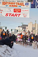 Musher DeeDee Jonrowe and Iditarider Beverley Nelms leave the 2011 Iditarod ceremonial start line in downtown Anchorage, Alaska