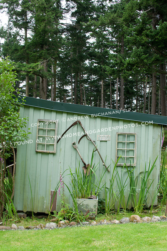 Antique garden tools decorate the outside of a simple garden shed on Washington State's Orcas Island.