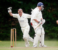 Highgate wicket keeper celebrates after P Plumbly is bowled by C Gourlay during the Middlesex County Cricket League Division Three game between Highgate and Hornsey at Park Road, Crouch End, London on Sat June 5, 2010