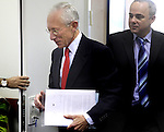 "Bank of Israel Governor Stanley Fischer (L) and Israeli Finance Minister Yuval Steinitz (R) after the former submitted the Bank of Israel report at the Finance Ministry in Jerusalem, Sunday, April 19, 2009. Stanley Fischer declared that ""the report says we are dealing with the current crisis relatively well"", although he did stress that he expects the decline to continue and that he believes that the Israeli economy has yet to reach its lowest point. Photo By: Emil Salman / JINI"