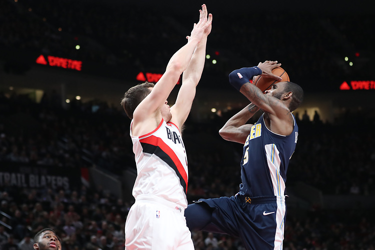 Denver Nuggets guard Will Barton (5) shoots around around Portland Trail Blazers guard Pat Connaughton (5) in the first half at Moda Center. <br /> Photo by Jaime Valdez