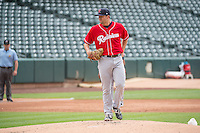 Cam Hobson (33) of the Tacoma Rainiers delivers a pitch to the plate against the Salt Lake Bees in Pacific Coast League action at Smith's Ballpark on May 7, 2015 in Salt Lake City, Utah. The Bees defeated the Rainiers 11-4 in the completion of the game that was suspended due to weather on May 6, 2015. (Stephen Smith/Four Seam Images)