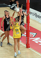 19.09.2013 Silver Ferns Casey Kopua and Australian Diamonds Caitlin Bassett in action during the Silver Ferns V Australian Diamonds New World Netball Series played at Vector Arena in Auckland. Mandatory Photo Credit ©Michael Bradley.