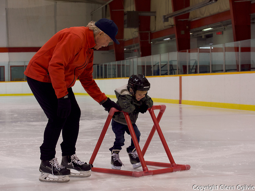 """Steve Hicken, of Sarnia with his two-year-old grandson Keaton a.k.a.""""Buster"""" Garvin.<br /> <br /> Hicken said he played a lot of local hockey when he was young including pick-up hockey and some travel as well. <br /> <br /> """"I have four grandchildren, three of them girls who don't like hockey,""""he said """" It's really important to me and Keaton seems to like skating."""""""