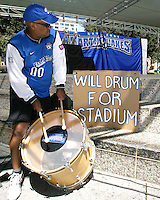 San Jose Earthquakes fan Guy Gayle demonstratues his support for the team at the Soccer Silicon Valley rally held in downtown San Jose, CA on August 20, 2004.  The non-profit Soccer Silicon Valley group hope to find a local buyer or soccer specific stadium for the Earthquakes within the next month so the team is not relocated to San Antonio or Houston, TX by its current investor/operator Anschutz Entertainment Group.