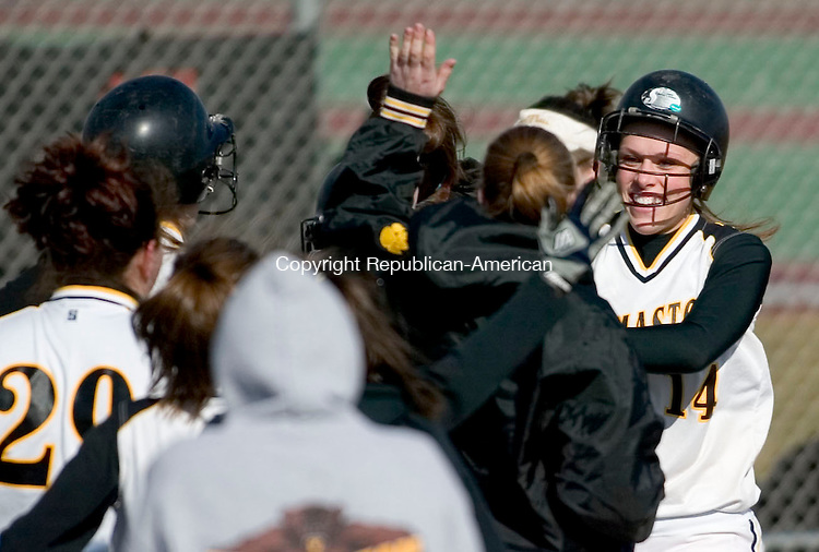 LITCHFIELD, CT- 10 APRIL 07- 041007JT06- <br /> Thomaston's Jaime Romano celebrates with teammates after hitting a two-run homer at Tuesday's game against Wamogo at Wamogo.<br /> Josalee Thrift Republican-American