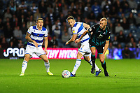 Marc Pugh of Queens Park Rangers vies for possession with Mike van der Hoorn of Swansea City during the Sky Bet Championship match between Queens Park Rangers and Swansea City at The Kiyan Prince Foundation Stadium in London, England, UK. Wednesday 21, August 2019