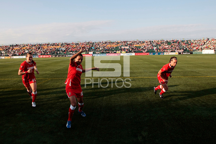 l-r Brittany Bock (21), Marta (10), and Whitney Engen (23) of the Western New York Flash warm up before the start of the match. The Western New York Flash defeated the magicJack 3-0 in Women's Professional Soccer (WPS) at Sahlen's Stadium in Rochester, NY May 22, 2011.