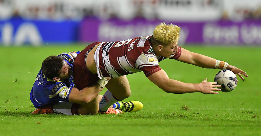 Wigan Warriors' George Williams is tackled by Warrington Wolves' Kurt Gidley<br /> <br /> Photographer Dave Howarth/CameraSport<br /> <br /> First Utility Super League Super 8s &ndash; Round 6 - Warrington Wolves v Wigan Warriors - Friday 16th September 2016 - Halliwell Jones Stadium - Warrington<br /> <br /> World Copyright &copy; 2016 CameraSport. All rights reserved. 43 Linden Ave. Countesthorpe. Leicester. England. LE8 5PG - Tel: +44 (0) 116 277 4147 - admin@camerasport.com - www.camerasport.com