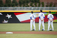 (L-R) Max Miller (5), Zack Kone (2) and Ryan Day (13) stand together during the National Anthem prior to the game against the California Golden Bears at Durham Bulls Athletic Park on February 20, 2016 in Durham, North Carolina.  The Blue Devils defeated the Golden Bears 6-5 in 10 innings.  (Brian Westerholt/Four Seam Images)