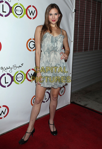 Reid Cox.Opening Of Kimberly Snyder's Glow Bio held at Glow Bio, West Hollywood, California, USA, 14th November 2012..full length white grey gray print dress hand on hip black t-bar shoes .CAP/ADM/RE.©Russ Elliot/AdMedia/Capital Pictures.