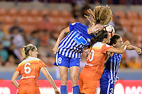 Houston, TX - Wednesday June 28, 2017: Julie King, Carli Lloyd, and Brooke Elby go up for a header close to the Boston goal  during a regular season National Women's Soccer League (NWSL) match between the Houston Dash and the Boston Breakers at BBVA Compass Stadium.