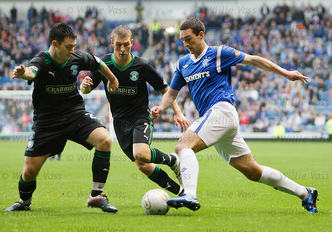 Lee Wallace cuts inside Richie Towell and David Wotherspoon