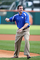 Buffalo Bulls athletic director Danny White throws out a first pitch before a game between the Pawtucket Red Sox and Buffalo Bisons at Coca-Cola Field on June 16, 2012 in Buffalo, New York.  Pawtucket defeated Buffalo 8-5.  (Mike Janes/Four Seam Images)