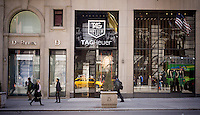 The TAG Heuer watch store on Fifth Avenue in New York on Thursday, March 19, 2015. The Swiss watchmaker announced it has partnered with Google and Intel to create a luxury smartwatch in competition with the Apple Watch and any other smartwatches on the consumer electronics horizon. The device is scheduled for an end of 2015 launch.  (© Richard B. Levine)
