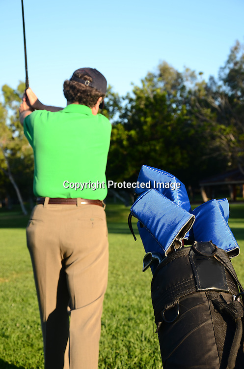 Stock photo morning golfer