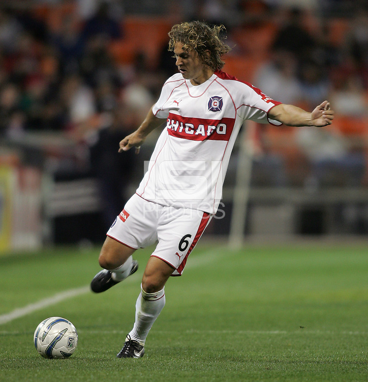 9 April 2005.   Kelly Gray (6) of the Chicago Fire punts the ball upfield at RFK Stadium in Washington, DC.