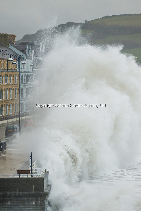 """Pictured: Waves crash against the seaside town of Aberystwyth, Wales, UK. Saturday 21 October 2017<br /> Re: Coastal parts of the UK is facing winds of up to 70mph as Storm Brian causes roads to close and public transport to be cancelled.<br /> Roads in Aberystwyth's seafront and at nearby Aberaeron, Wales are shut on Saturday morning as a yellow """"be aware"""" Met Office warning is in place.<br /> Seven flood warnings have been issued for the west Wales coast."""