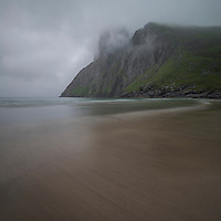 Low misty clouds hide the summit of Ryten over Kvalvika beach, Moskenesøy, Lofoten Islands, Norway