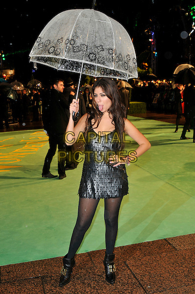GABRIELLA CILMI.Royal World Film Premiere of 'Alice in Wonderland' at the Odeon cinema, Leicester Square, London, England, UK,.25th February 2010.arrivals full length holding umbrella raining flowers black mini dress tights hand on hip tongue sticking out funny ankle boots paillettes sequined layered sequin sleeveless gold buckles .CAP/PL.©Phil Loftus/Capital Pictures