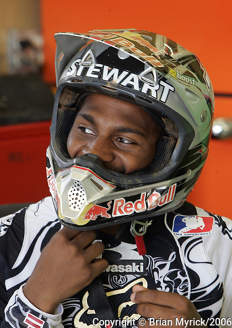 """AMA Supercross star James """"Bubba"""" Stewart puts on his helmet prior to a practice sesson at a private supercross track on his family's 100-acre farm in Haines City, Fla., Wednesday, April 19, 2006.(AP Photo/Brian Myrick)"""