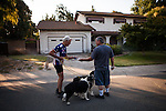 """SACRAMENTO, CA - JULY 3, 2014:  Sacramento City water waste inspector Ron Carpenter hands a violation notice to a resident on one of Sacramento's enforced """"no watering"""" days. CREDIT: Max Whittaker for The New York Times"""