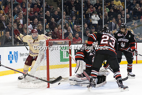 Bill Arnold (BC - 24) celebrates as the puck shot in by Kevin Hayes heads back out of the net. - The Boston College Eagles defeated the Northeastern University Huskies 4-1 (EN) on Monday, February 10, 2014, in the 2014 Beanpot Championship game at TD Garden in Boston, Massachusetts.