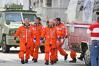 Endeavour STS-134 crew walks before a cheering crowd to board an Airstream, headed to the launch pad, shortly before  NASA halted the countdown to liftoff due to mechanical woes at Kennedy Space Center, Cape Canaveral, Florida, USA, Friday, April 29, 2011. Photo by Debi Pittman Wilkey