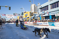 Mats Pettersson and team leave the ceremonial start line with an Iditarider and handler at 4th Avenue and D street in downtown Anchorage, Alaska on Saturday March 4th during the 2017 Iditarod race. Photo © 2017 by Brendan Smith/SchultzPhoto.com.