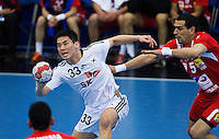 05 APR 2012 - LONDON, GBR - South Korea's Hyo-Won Eom (KOR) looks for a way through the Tunisian defence during their 2012 London Cup match at the National Sports Centre in Crystal Palace, Great Britain(PHOTO (C) 2012 NIGEL FARROW)