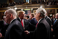 FEBRUARY 5, 2019 - WASHINGTON, DC: President Trump shook hands with Senator Mitch McConnell, R-KY, after the State of the Union at the Capitol in Washington, DC on February 5, 2019. <br /> CAP/MPI/RS<br /> ©RS/MPI/Capital Pictures