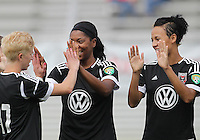 BOYDS, MARYLAND - July 21, 2012:  Joanna Lohman (17) of DC United Women greets Tiffany Brown (9) and Lianne Sanderson (10) before playing against the Virginia Beach Piranhas during a W League Eastern Conference Championship semi final match at Maryland Soccerplex, in Boyds, Maryland on July 21. DC United Women won 3-0.