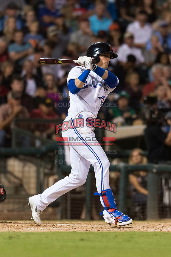 AFL West left fielder Cavan Biggio (26), of the Surprise Saguaros and Toronto Blue Jays organization, follows through on his swing during the Arizona Fall League Fall Stars game at Surprise Stadium on November 3, 2018 in Surprise, Arizona. The AFL West defeated the AFL East 7-6 . (Zachary Lucy/Four Seam Images)
