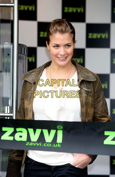 GEMMA ATKINSON.Opens the new Zavvi store in Camberley, Surrey, England, .14th March 2008..half length gold disc necklace brown jacket cream ruffle top.CAP/DS.©Dudley Smith/Capital Pictures