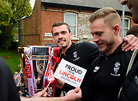 Lincoln City's Harry Toffolo, left, and Danny Rowe with the League 2 Trophy during the Open Top Bus parade through Lincoln<br /> <br /> Photographer Chris Vaughan/CameraSport<br /> <br /> The EFL Sky Bet League Two - Lincoln City - Champions Parade - Sunday 5th May 2019 - Lincoln<br /> <br /> World Copyright © 2019 CameraSport. All rights reserved. 43 Linden Ave. Countesthorpe. Leicester. England. LE8 5PG - Tel: +44 (0) 116 277 4147 - admin@camerasport.com - www.camerasport.com
