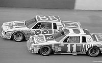 Darrell Waltrip (#11) and Bobby Allison race side by side  at Atlanta in November 1982. (Photo by Brian Cleary)