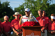 Bethesda, MD - June 29, 2014: Justin Rose celebrates at the podium about to receive the Quicken Loan National trophy at Congressional Country Club in Bethesda MD. The win gives Rose a total of six PGA Tour titles. (Photo by Phillip Peters/Media Images International)