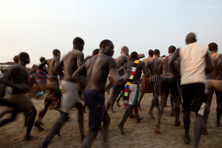 Sunday 5 december 2010 - Juba, Southern Sudan - Mundari wrestlers team celebrates their victory after a traditional wrestling match in Juba Stadium between Dinka wrestlers from Yirol East of Lake State and the Mundari wrestlers from Terekeka County of Central Equatoria State. The matches attracted large numbers of spectators who sang, played drums and danced in support of their favorite wrestlers. The match organizers hoped that the sport would bring together South Sudan's many different tribes.Photo credit: Benedicte Desrus