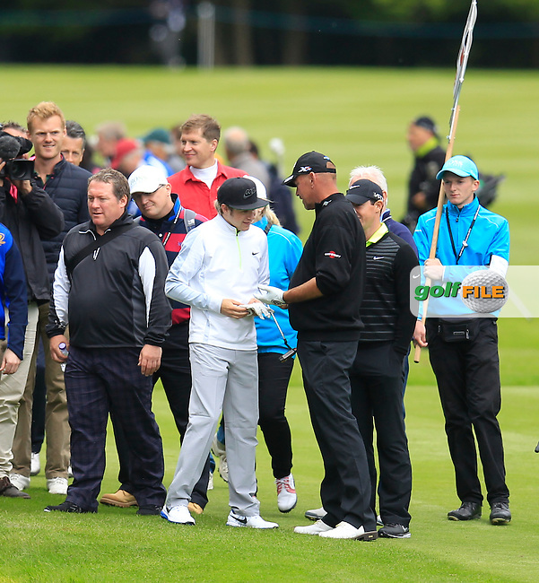 Niall Horan signs a glove for Thomas Bjorn (DEN) during the Pro-AM of the 2015 BMW PGA Championship. Wentworth Golf Club, Virginia Water, Surrey, UK. 20/05/2015.<br /> Picture Fran Caffrey, www.golffile.ie