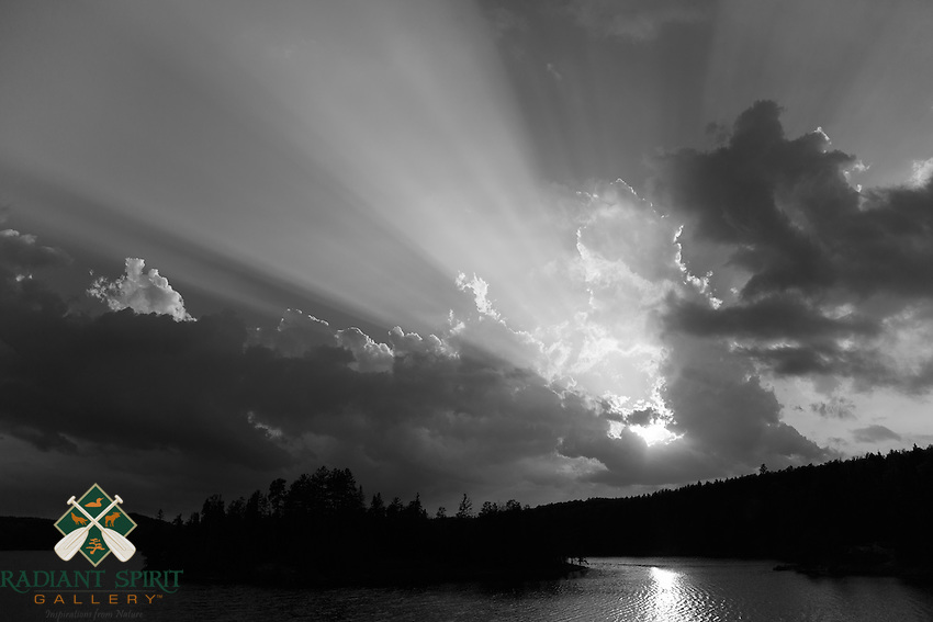 &quot;Sunset of Inspiration&quot;<br /> <br /> The very humid air from approaching thunderstorms causes the setting sun  to cast brilliant rays of light.<br /> ~ Day 123 of Inspired by Wilderness: A Four Season Solo Canoe Journey