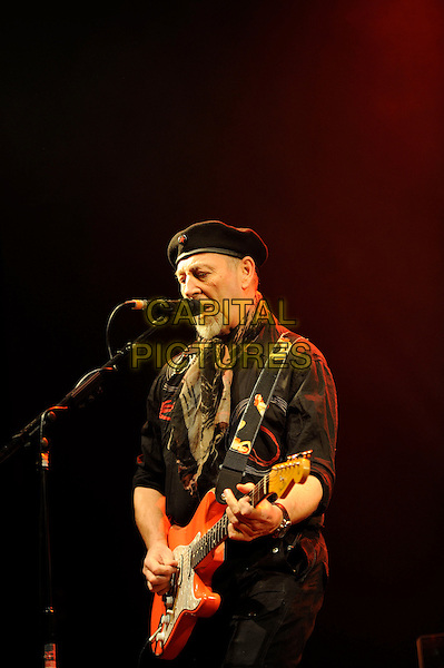 Richard Thompson.performing in concert, Shepherd's Bush Empire, London, England. .25th February 2013.on stage lie gig performance music half length hat flat cap scarf black shirt profile  singing guitar goatee facial hair .CAP/MAR.© Martin Harris/Capital Pictures.