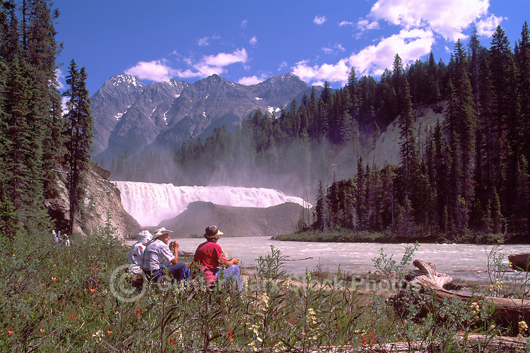 Yoho National Park, Canadian Rockies, BC, British Columbia, Canada - Hikers resting beside Wapta Falls, Kicking Horse River, Summer