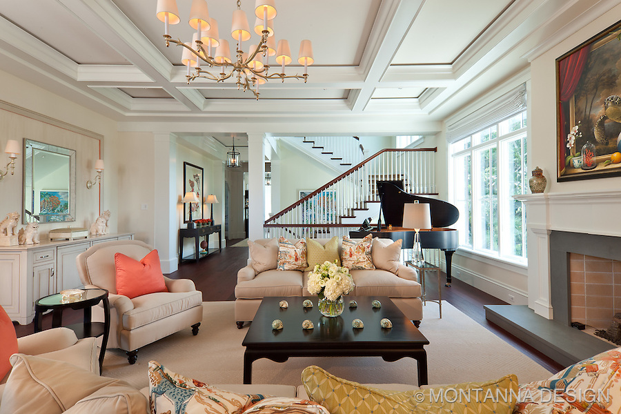 The formal family room is classic neutral with pops of corals and lime greens