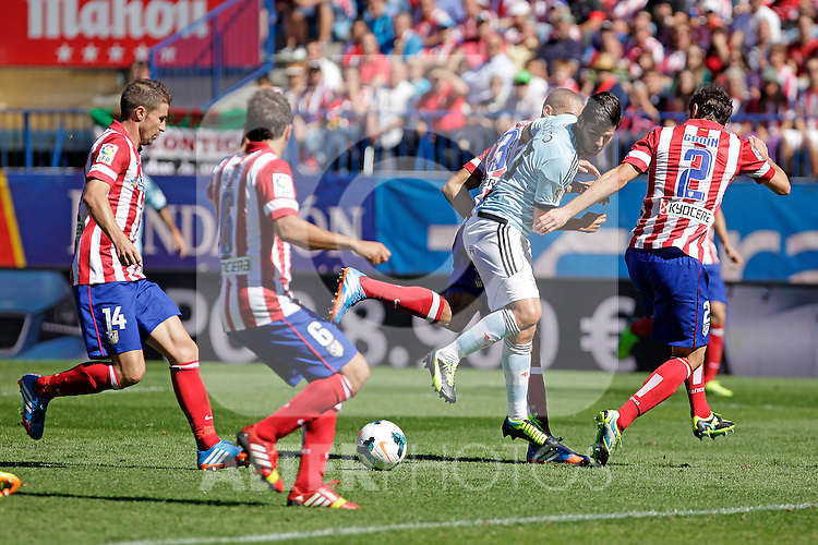 Atletico de Madrid´s and Celta de Vigo´s Nolito (C) during La Liga 2013/14 match. October 06, 2013. (ALTERPHOTOS/Victor Blanco)