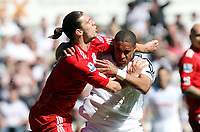 Barclay Premier League, Swansea City (white) V Liverpool (red) Liberty Stadium, 13/05/12<br /> Pictured: Andy Carroll and Ashley Williams came to blows after a challenge by Williams.<br /> Picture by: Ben Wyeth / Athena <br /> info@athena-pictures.com